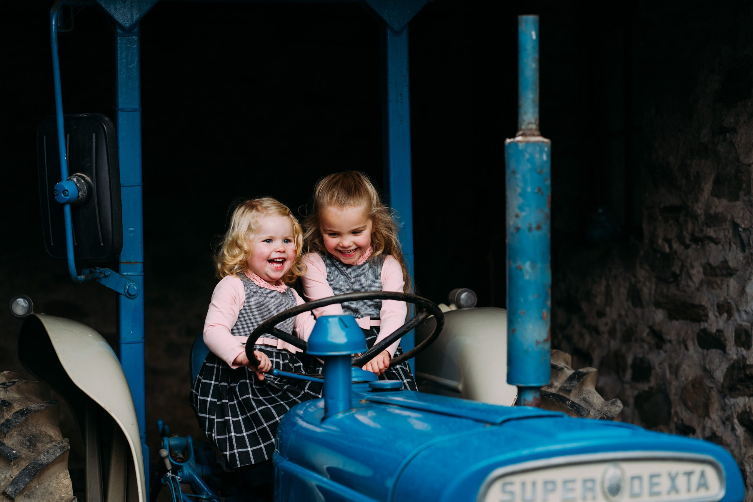 Sisters on tractors